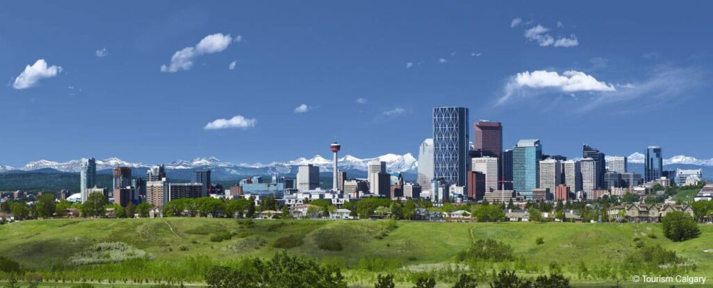 The Calgary skyline with the Banff Rocky Mountains in the Sitance