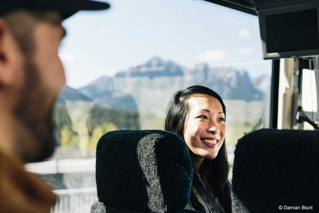 A passenger enjoying transportation from Calgary to Banff