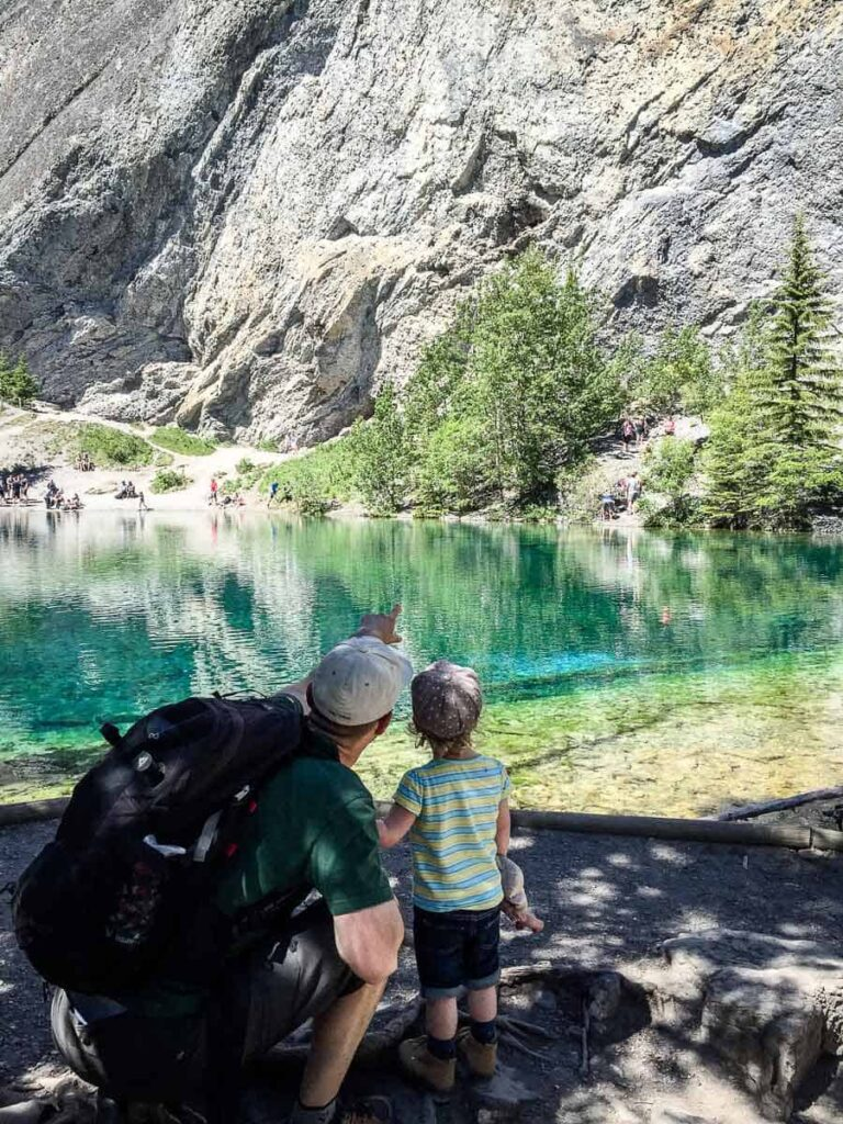A father shows his toddler where the Great Horned Owl is nesting behind the Grassi Lakes Canmore