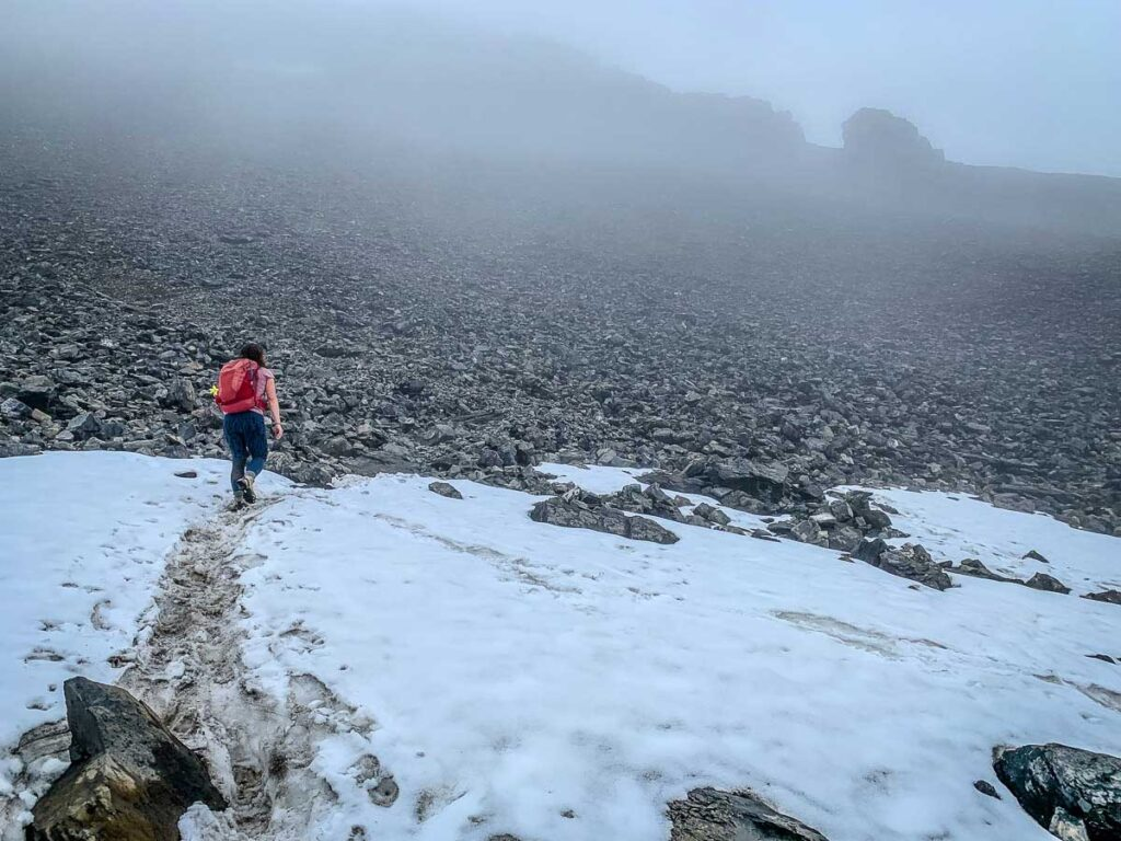 You can encounter snow in the summer while hiking Mt. Rundle - bring layers of clothing for hiking safety