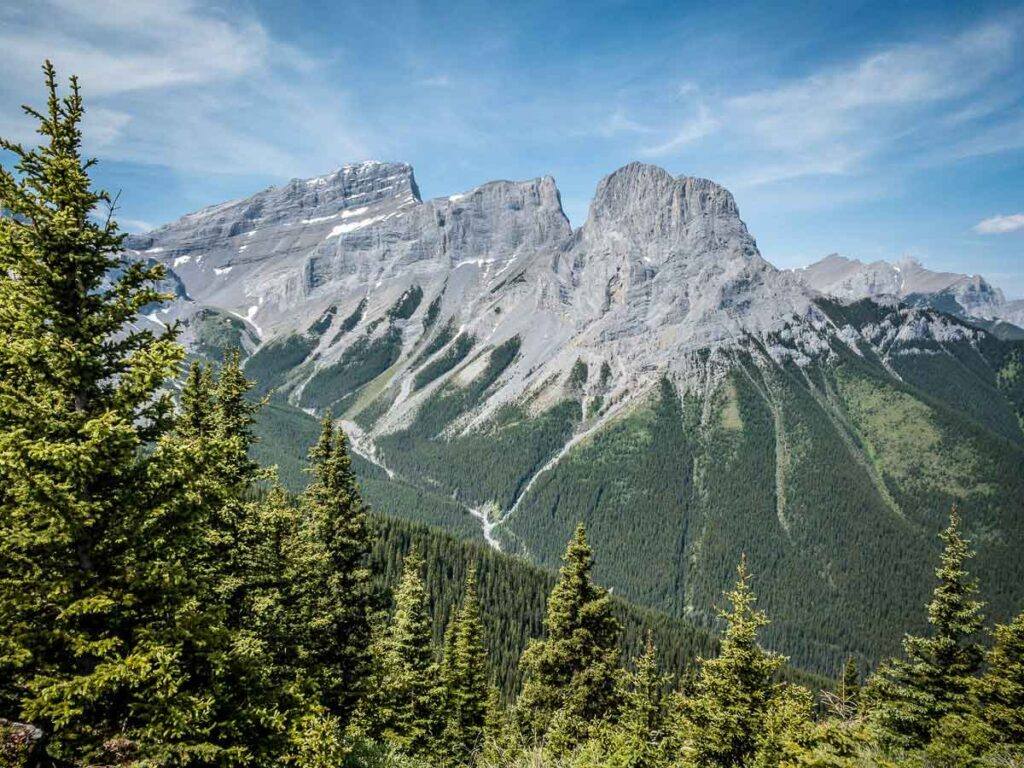 Canmore's Three Sisters as seen from behind on the Windy Lookout Trail in Kananaskis