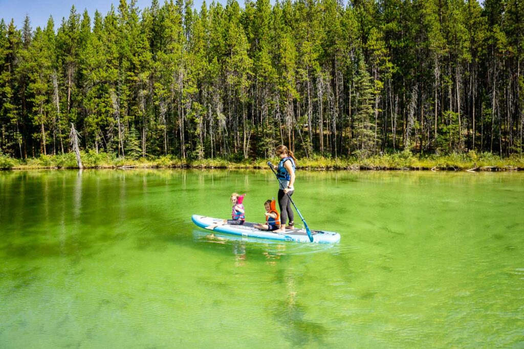 Banff paddle boarding on Herbert Lake along Icefields Parkway