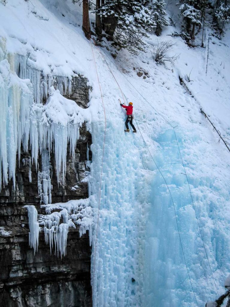 ice climber at Johnston Canyon - winter hike banff