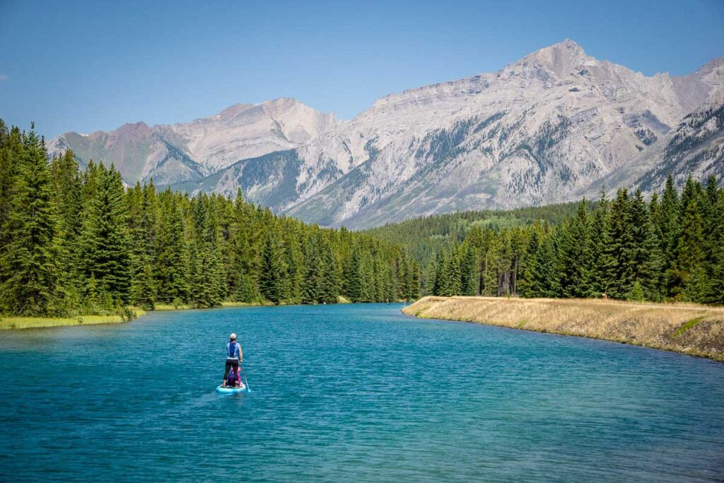 two jack lake paddle boarding in Banff with kids