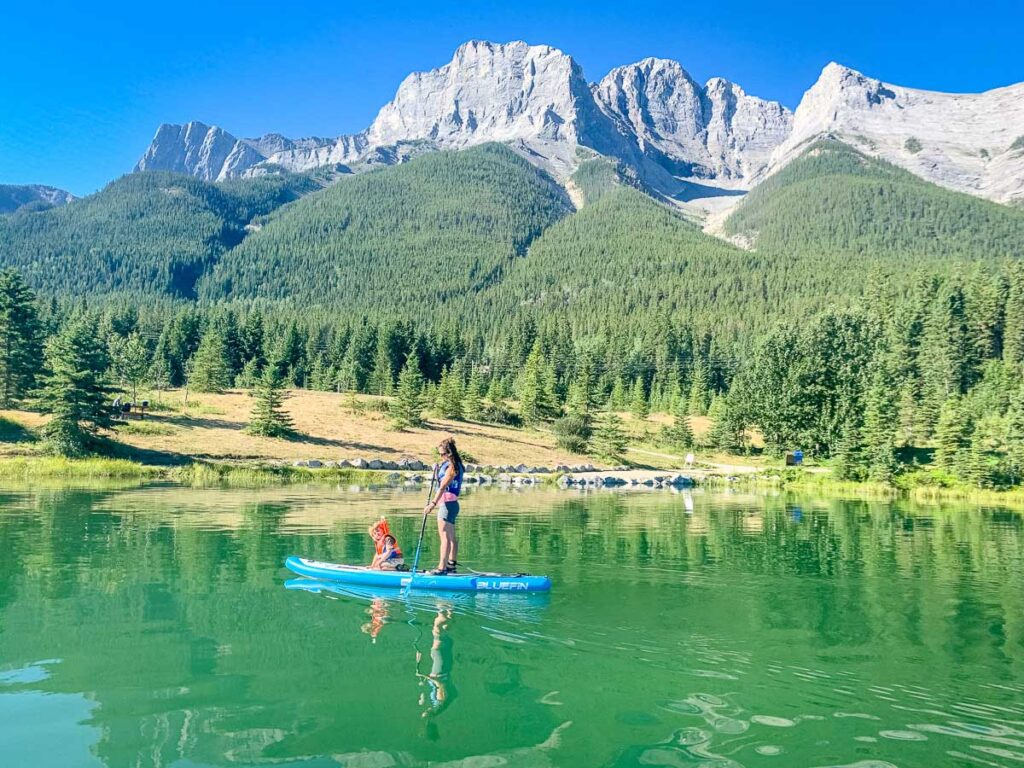 Quarry Lake paddle boarding with kids in Canmore