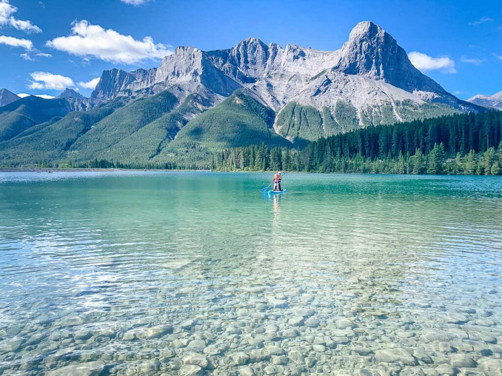 paddle boarding on reservoir in Canmore