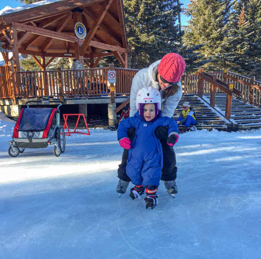 A family enjoys skating a the Canmore Pond in December