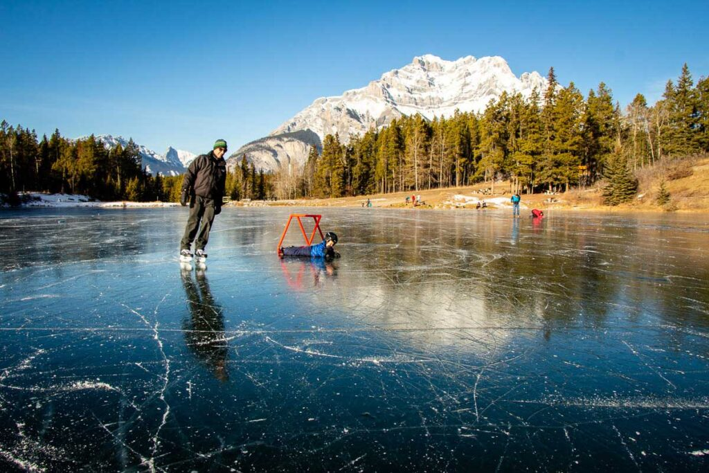 Wild ice skating on Johnson Lake in Banff National Park