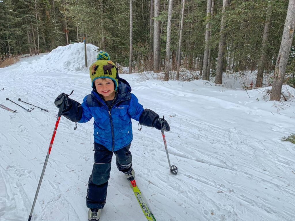 Cross country skiing with kids on the Braille Trail in Kananaskis Country, Alberta