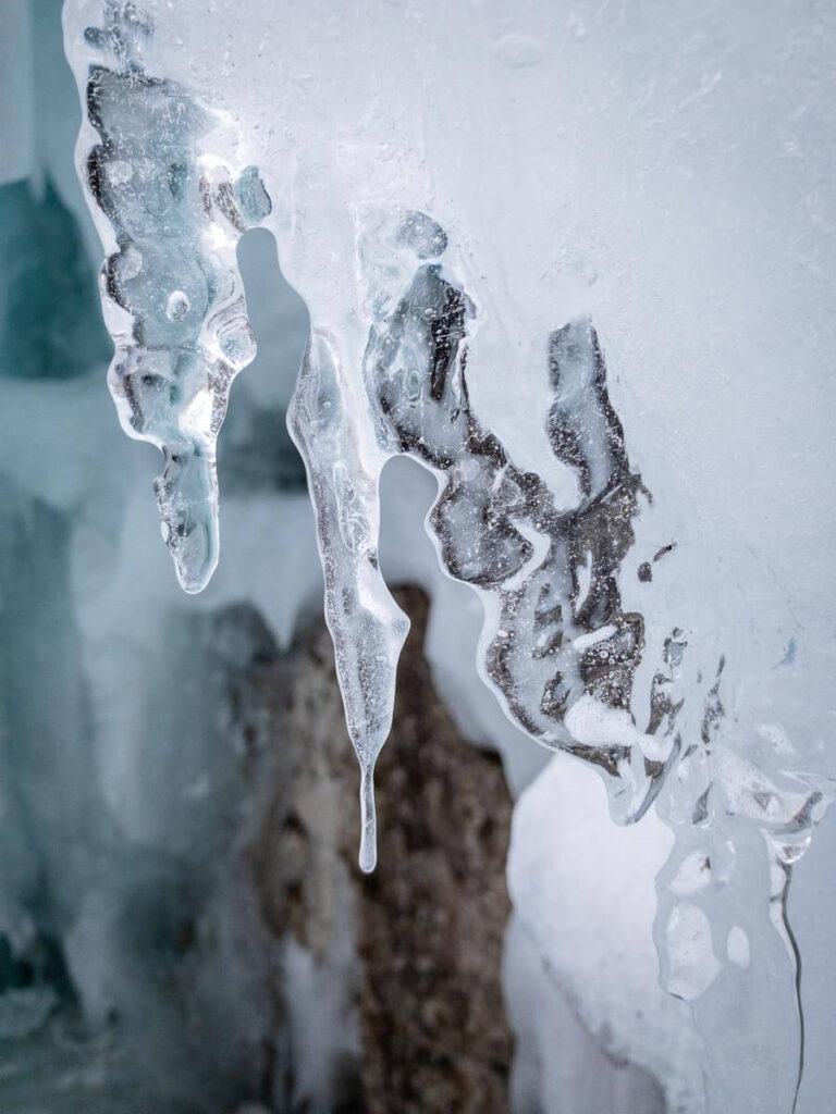 A beautiful icicle hangs off a frozen waterfall on Grotto Canyon Trail in winter