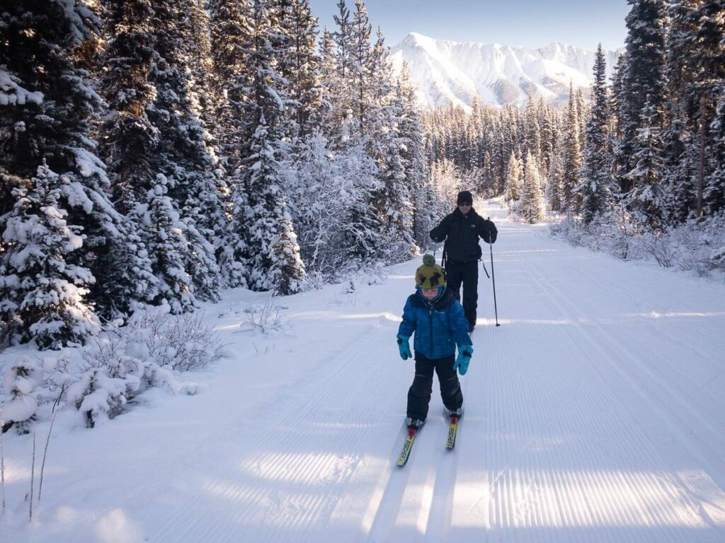Cross country skiing at Watridge Lake Trail is a fun winter activity for families in Kananaskis Country