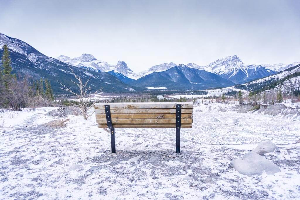 Enjoy views of Gap Lake, Mt. Lougheed, Wind Ridge and the Three Sisters from tis bench on the Grotto Canyon Trail in winter