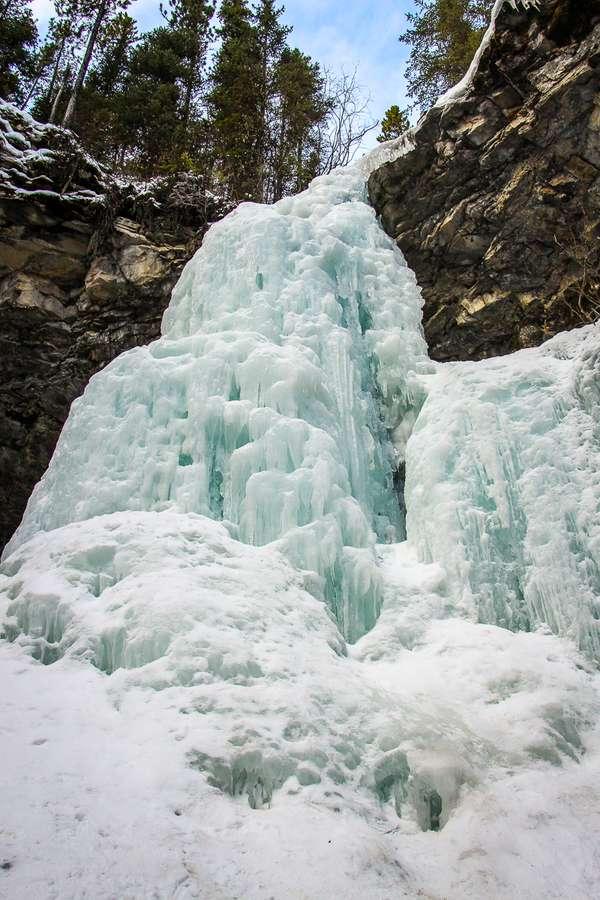 The Troll Falls trail near Kananaskis village is a very popular kid-friendly winter hike or snowshoe trail