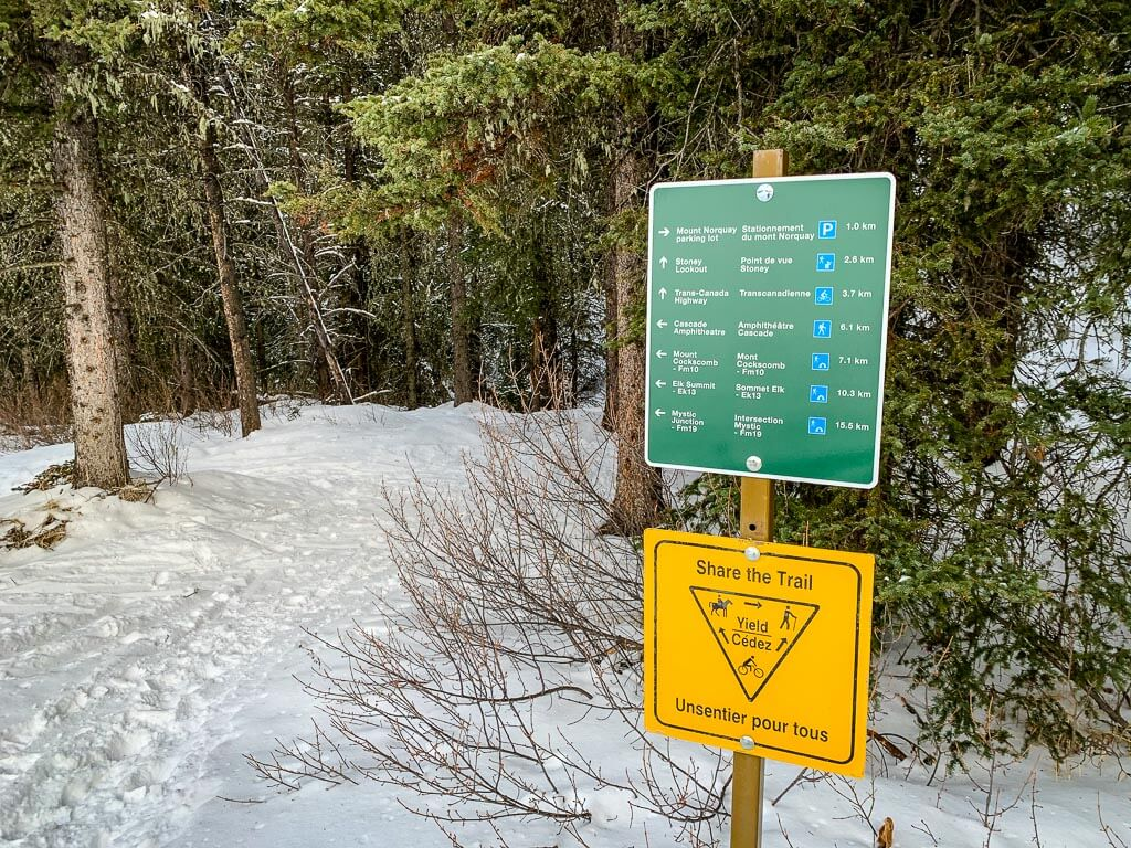 Trail sign below the Norquay Mystic chair showing the Cascade Amphitheatre trailhead