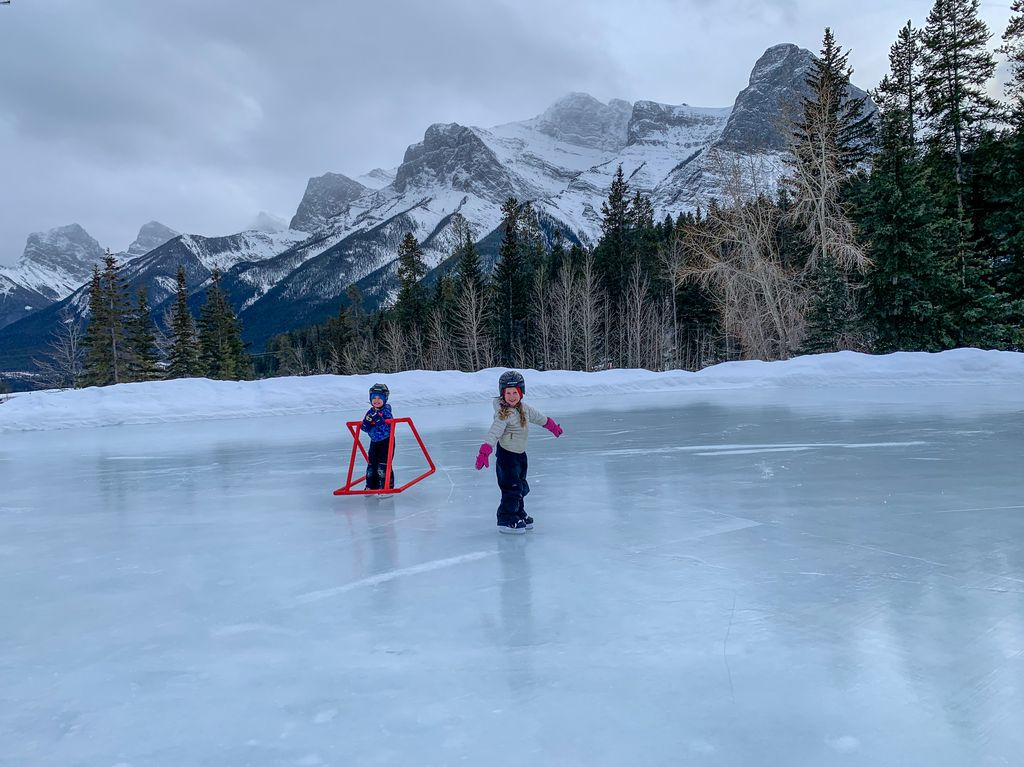Canmore Nordic Centre ice skating rink offers views of Ha Ling Peak, Miners Peak, Mt. Lawrence Grassi, Ships Prow and the Three Sisters