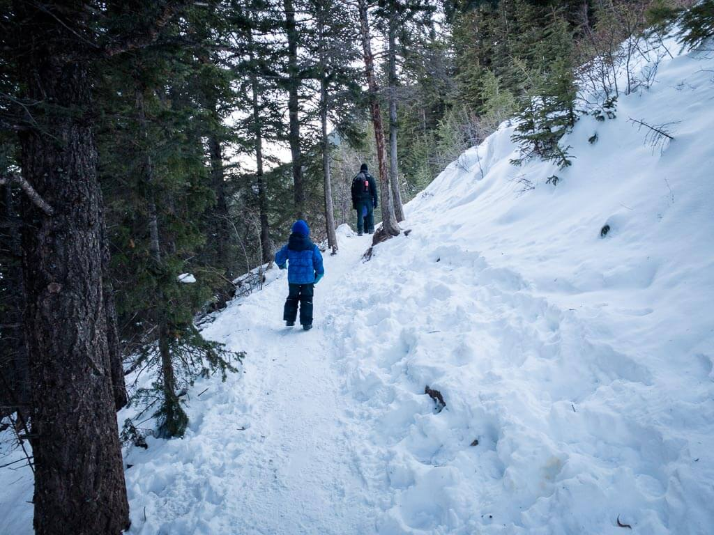 Traction devices will help on the slippery hills hiking Heart Creek in winter
