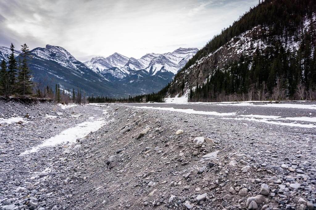 Beautiful Kananaskis mountains in winter seen from the Jura Creek riverbed