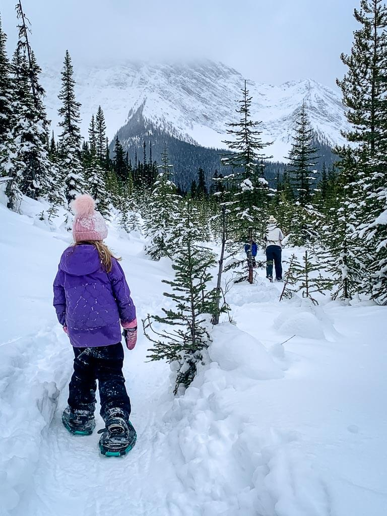 Dress in layers while snowshoeing in Kananaskis in winter