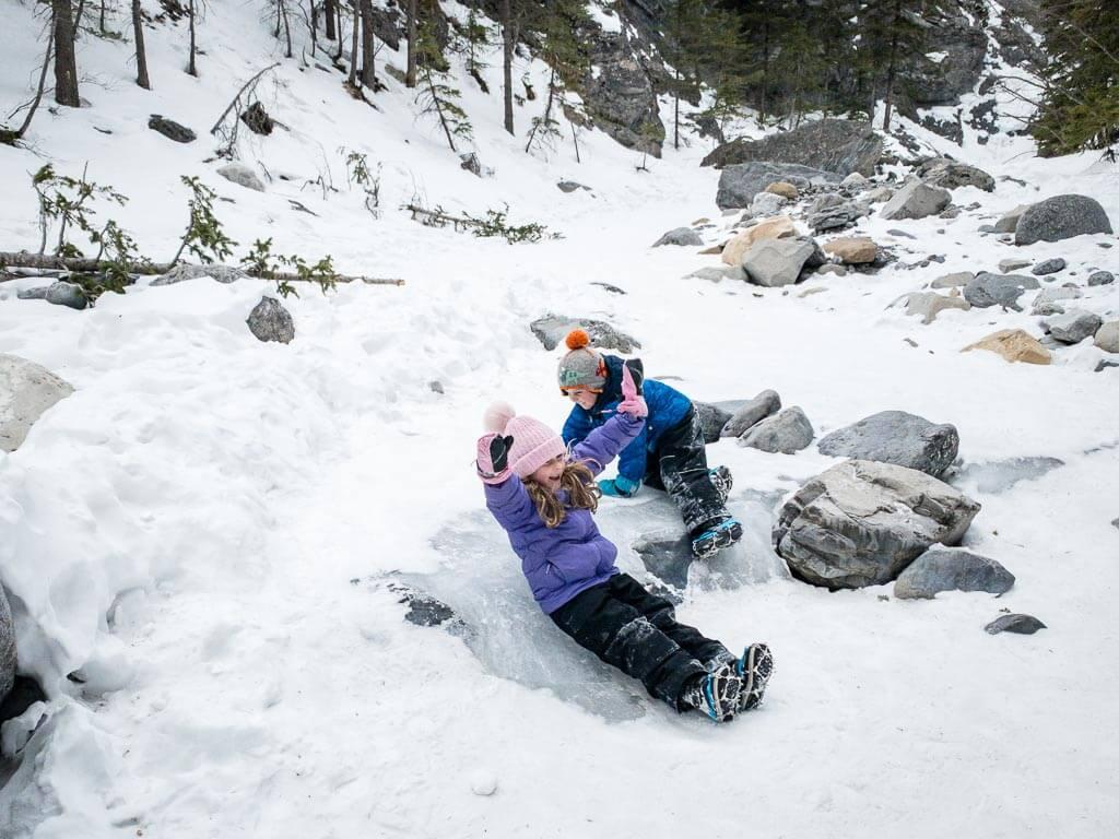 Kids love Jura Creek in winter - sliding down frozen waterfalls