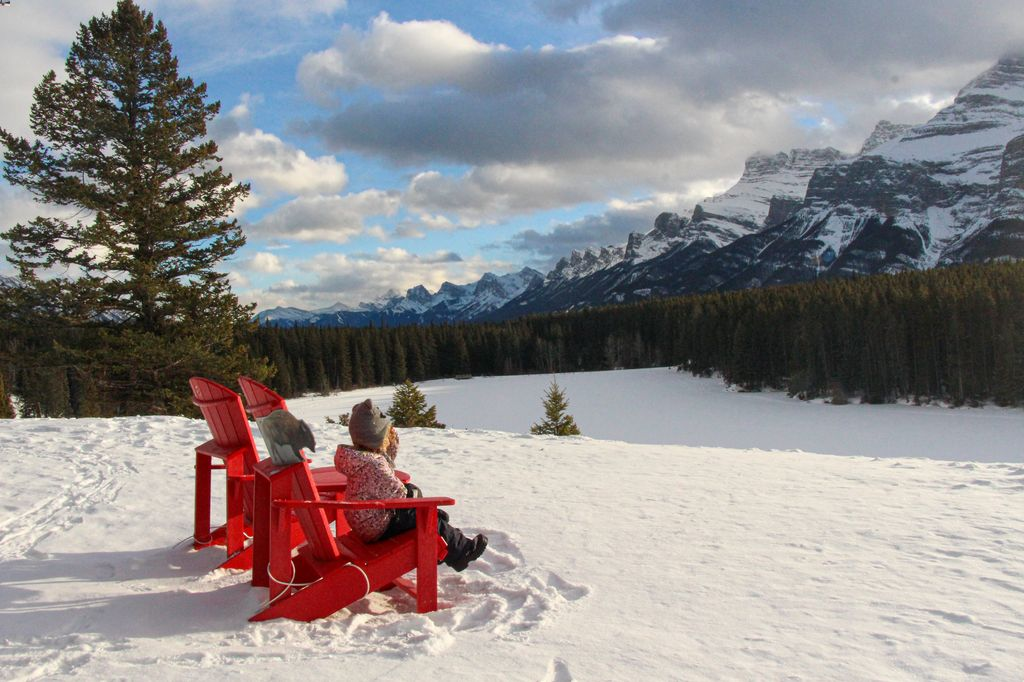 When visiting Banff in January, try to find the locations of the red chairs in Banff National Park. These red chairs are at Johnson Lake