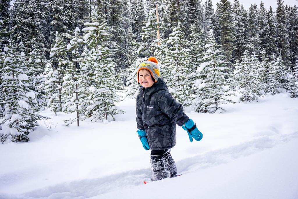 Kids snowshoeing in Kananaskis should wear winter boots, snow pants, a fleece top, a winter jacket, good winter gloves and a warm toque