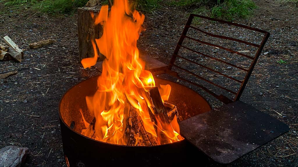 fire burning in fire pit - Canmore Campgrounds