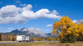 truck pulling trailer driving in Kananaskis - camping