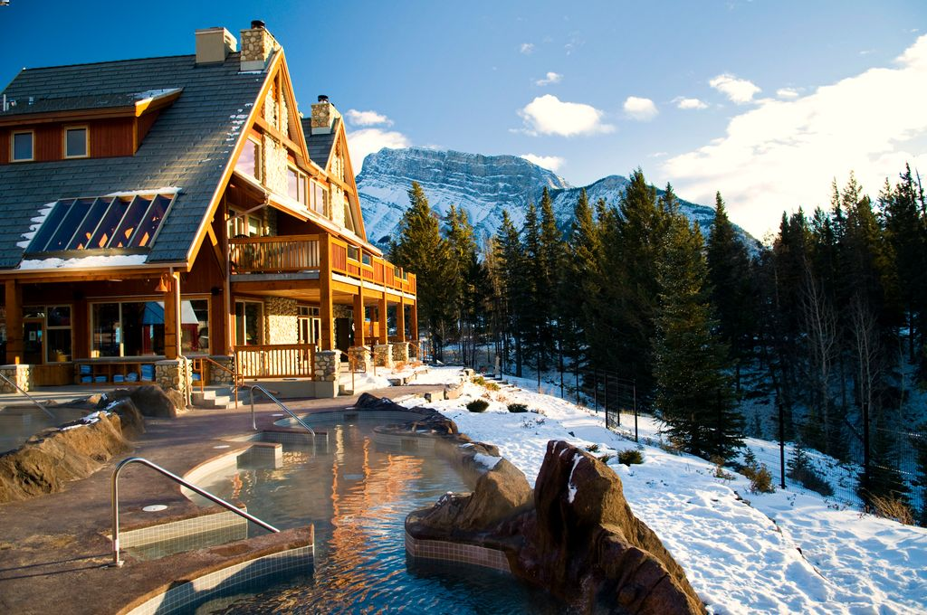 Kids will love the beautiful outdoor pool at the family-friendly Hidden Ridge Resort in Banff, Canada
