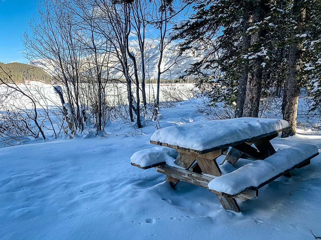 Picnic table on the shores of Lower Kananaskis Lake