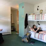A single bed in a dorm room at the Samesun Banff Backpacker Lodge may be the cheapest place to stay in Banff, Alberta