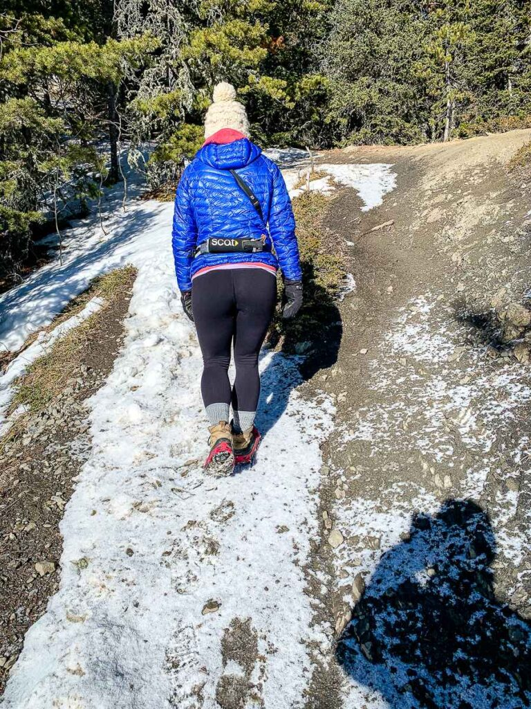 hiking in Kananaskis in spring - using ice cleats on the Yates Mountain Trail near Barrier Lake