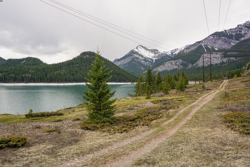 The Yates Mountain Loop Trail follows the shores of Barrier Lake on the Stoney Trail