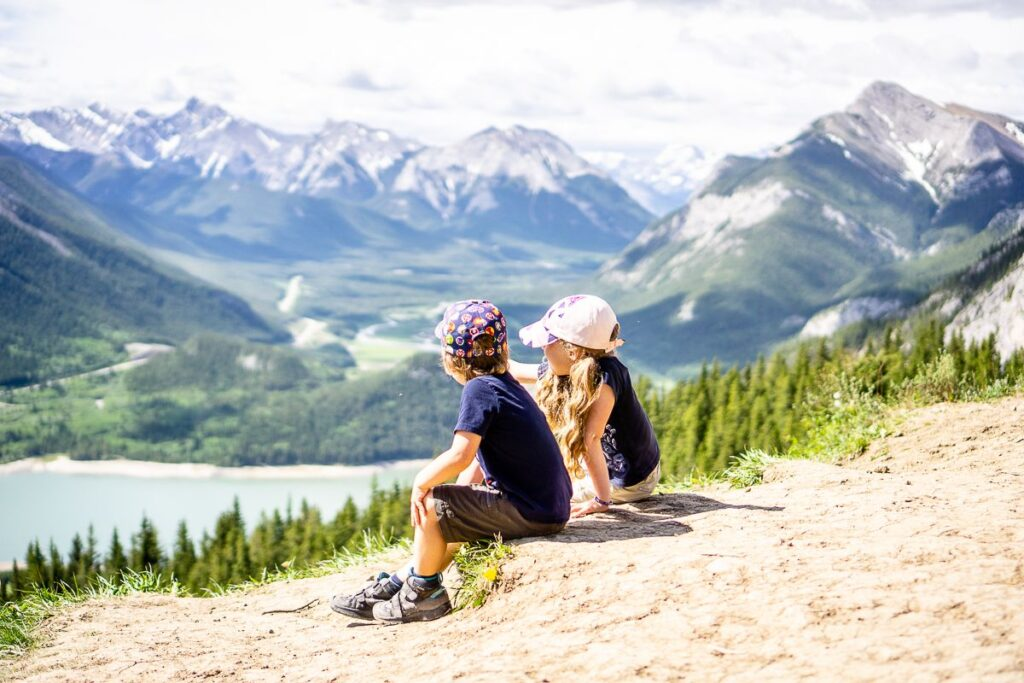hiking with kids in Kananaskis - enjoying views of Barrier Lake from Yates Mountain Trail on Father's Day