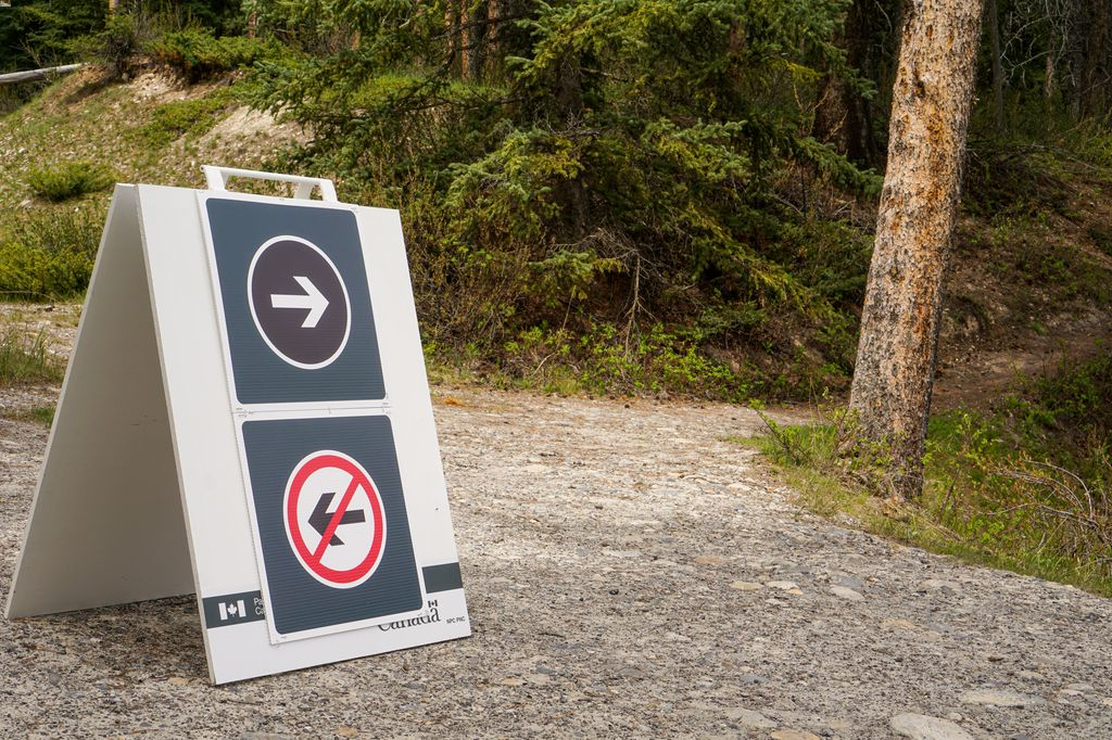 To promote social distancing, Parks Canada has installed many one-way signs along the Johnson Lake Trail in Banff National Park