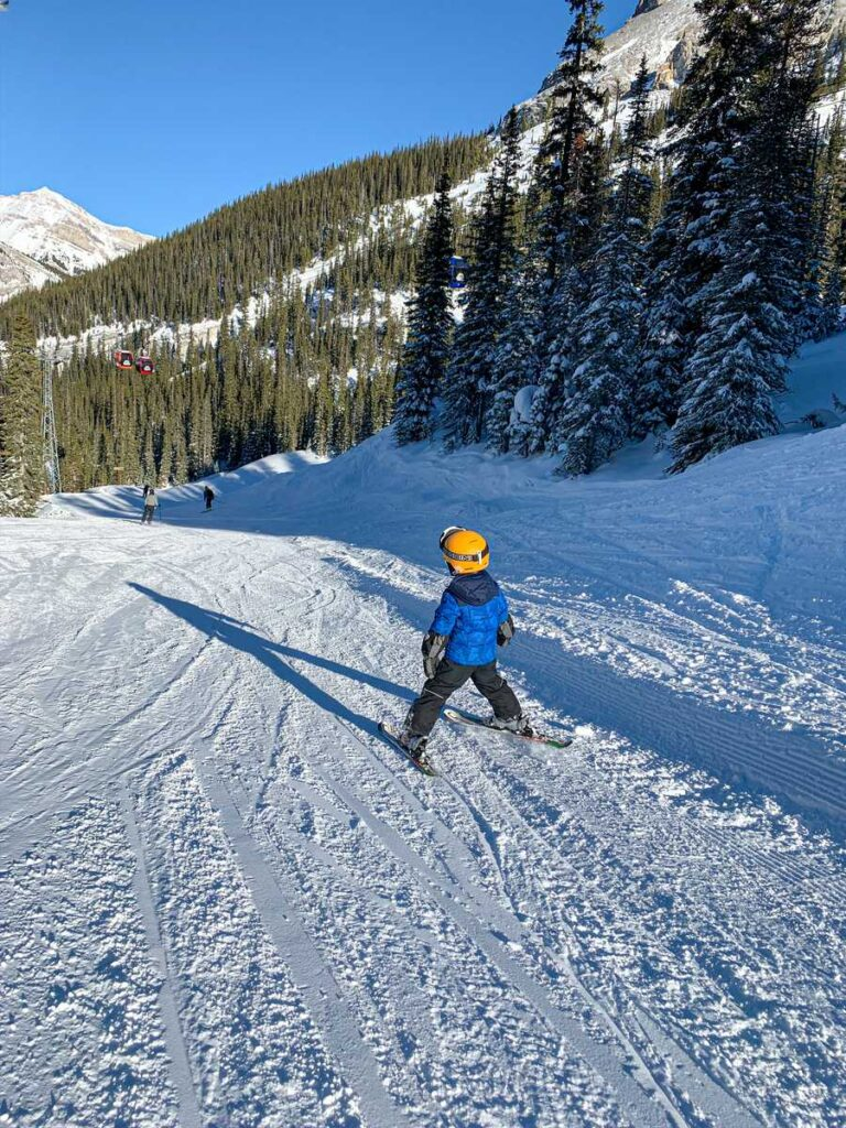 The Sunshine ski out is a super fun, long green run perfect for kids or beginner skiers at this top Banff ski resort