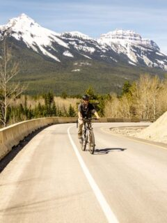 Bow Valley Parkway Cycling with Mountain Views in background