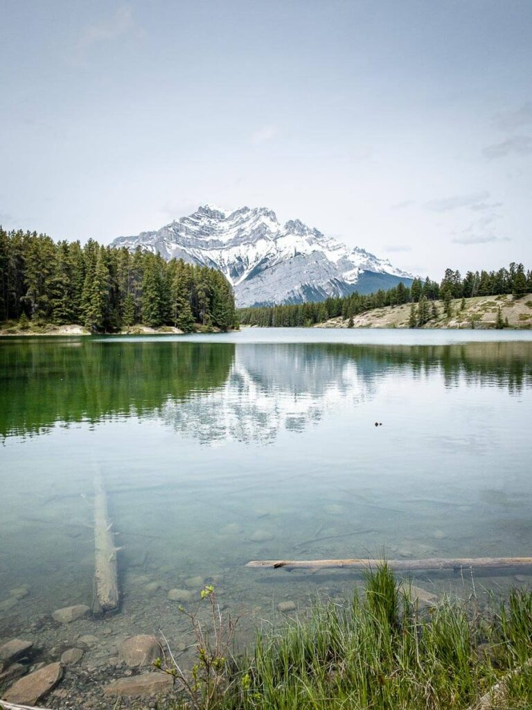 A reflection of Cascade Mountain as seen from the Johnson Lake hiking trail in Banff National Park, Canada