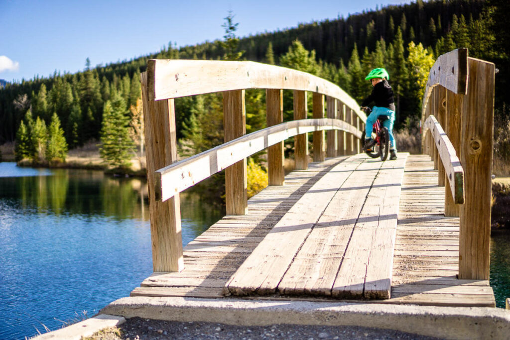 Crossing bridge at Cascade Ponds in Banff National Park with Kids