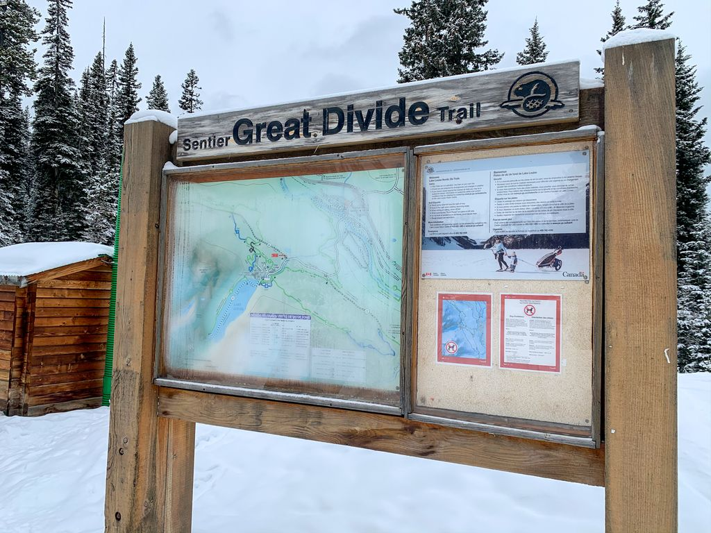 The free parking at Great Divide trailhead is only a 1km hike to the Lake Louise lakefront