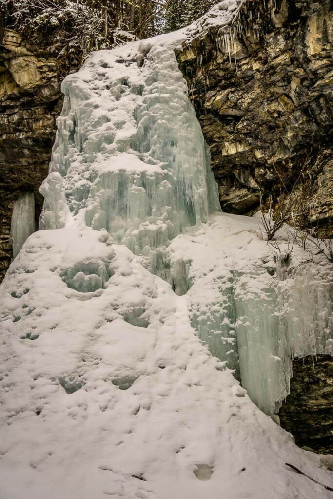 Frozen marmot creek waterfalls on the Troll Falls winter hike