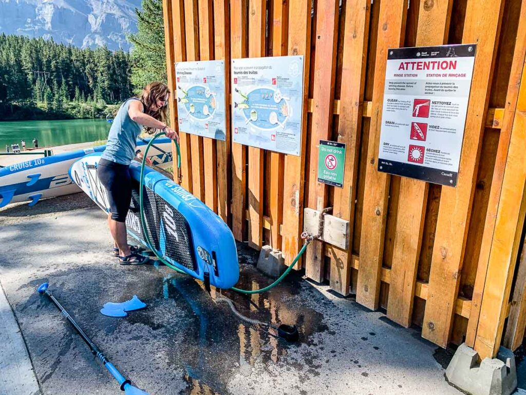 Help fight invasive species in Banff National Park by using the rinse station for your SUP, kayak or dinghy at Johnson Lake