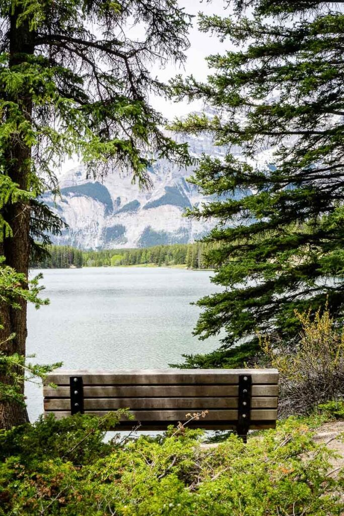 This park bench along Johnson Lake in Banff offers amazing views of Cascade Mountain across the water