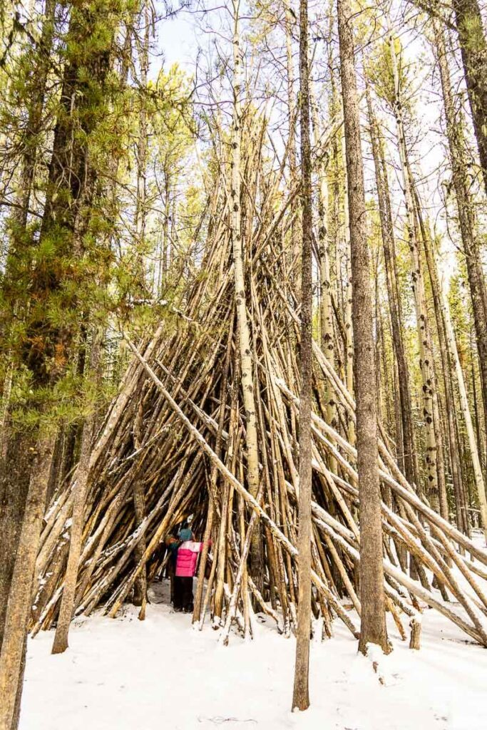 The many teepees along the Troll Falls hike make it a popular kid-friendly hike in Kananaskis Country, Alberta