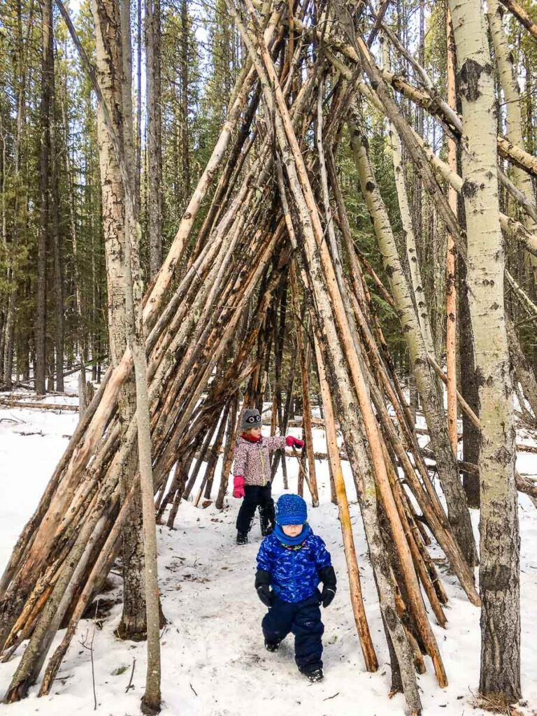 When hiking Kananaskis with kids, try the easy Troll Falls trail - the kids will love all the teepees
