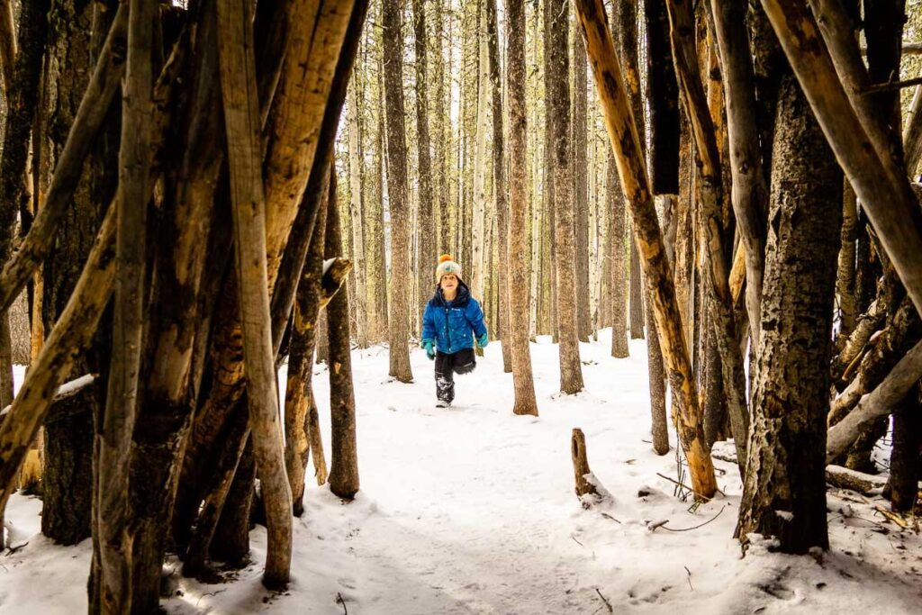 Kids love playing in the teepees (tipis) on the Troll Falls hike in Kananaskis
