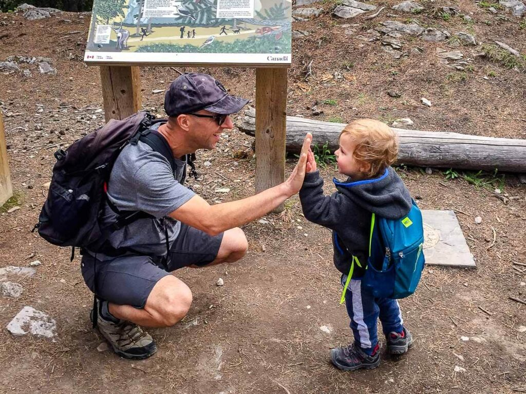 Reaching summit of Tunnel Mountain Banff hike with kids