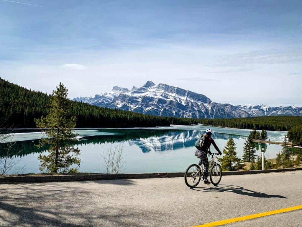 Cycling Lake Minnewanka Loop past Two Jack Lake in Banff