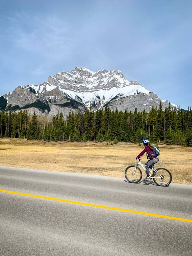 Cycling Lake Minnewanka Loop Road with Cascade Mountain in background