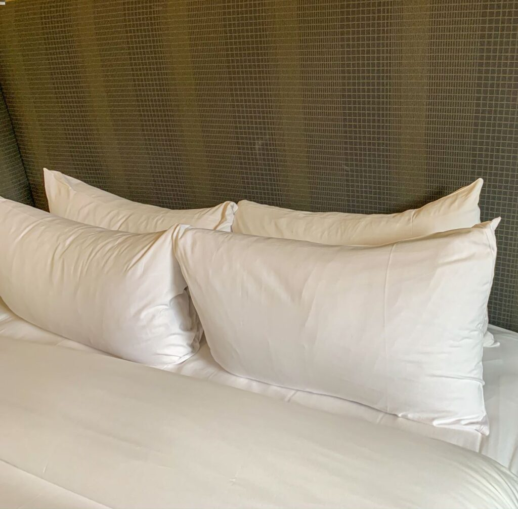 Enjoy 4 large, fluffy pillows on a King sized bed in a Fairmont Room at the Banff Springs Hotel, Canada