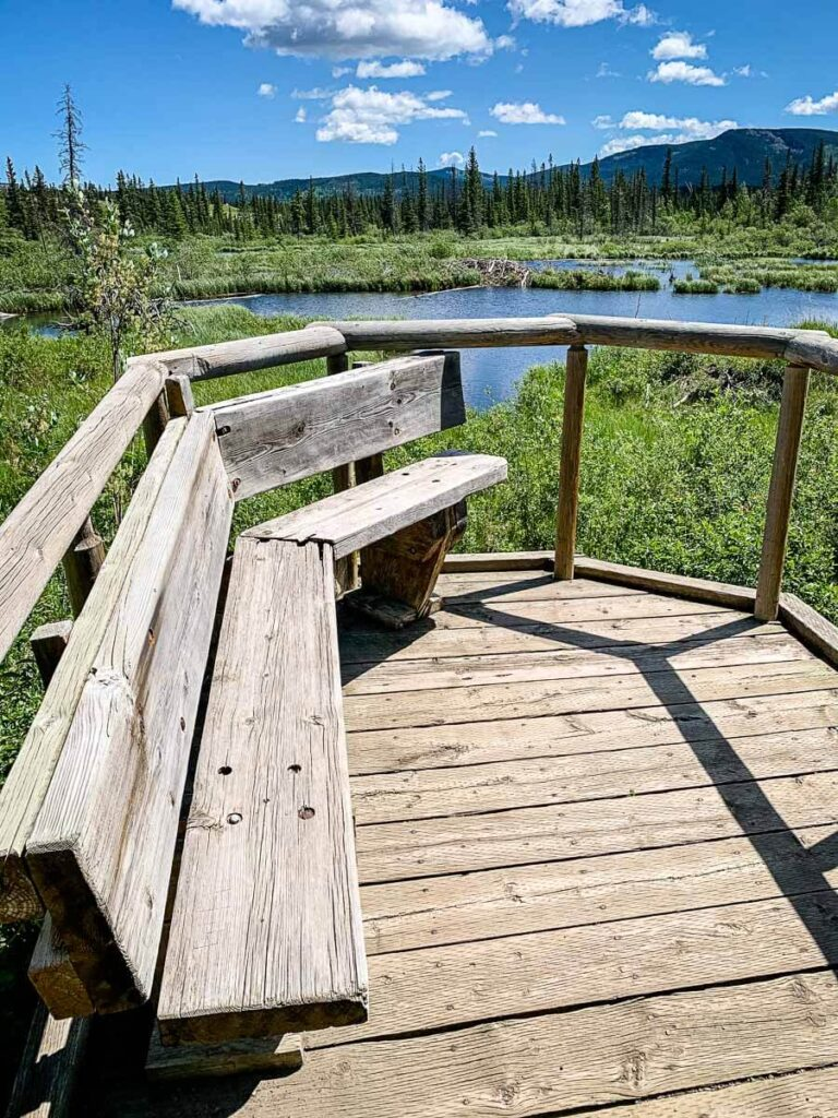 wooden platform and Benches overlooking Beaver Dam on Flowing Water Trail
